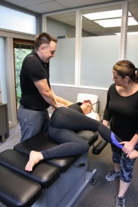 Dr. Eric DeRoche performs Active Release Technique on a patient.