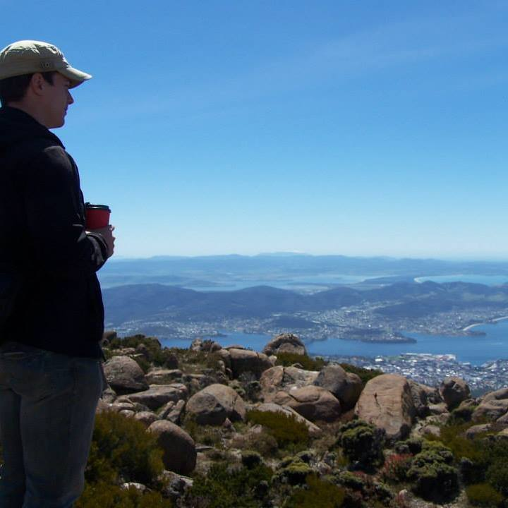 Dr. Swick atop a mountain in Tasmania