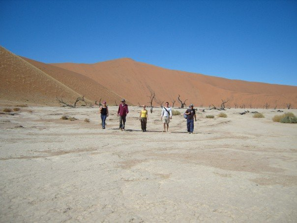 Dr. Swick walking on a desert flat in Namibia